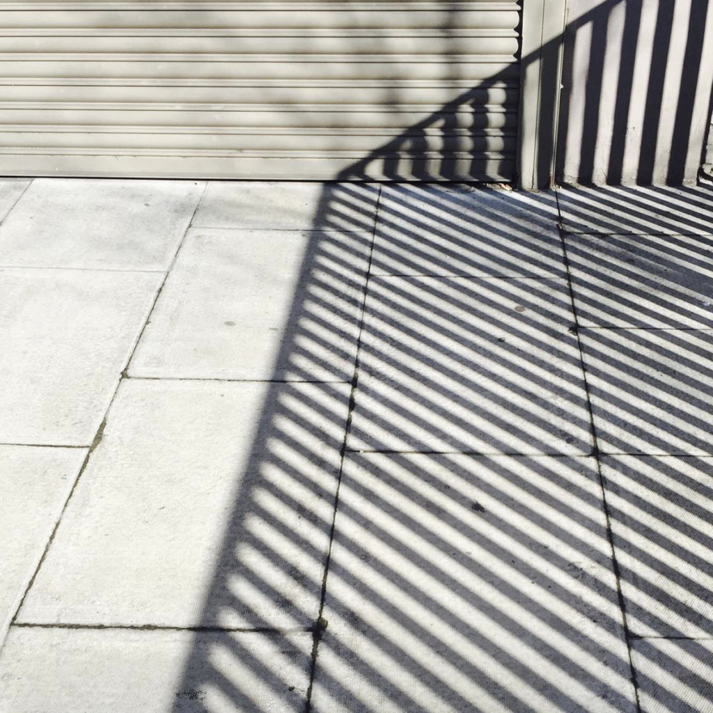 A keen eye for spotting geometric pattern in the urban environment is also evident in images like this one.